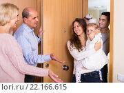 Купить «Mature people welcoming dear guests», фото № 22166615, снято 17 декабря 2017 г. (c) Яков Филимонов / Фотобанк Лори