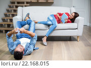 Купить «Happy couple using technology», фото № 22168015, снято 13 ноября 2015 г. (c) Wavebreak Media / Фотобанк Лори
