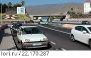 Купить «Развязка на автомагистрали TF-1 при выезде из города Коста Адехе (Costa Adeje). Тенерифе, Канарские острова, Испания», видеоролик № 22170287, снято 1 февраля 2016 г. (c) Кекяляйнен Андрей / Фотобанк Лори