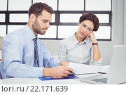 Купить «Serious business people working with documents in office», фото № 22171639, снято 1 ноября 2015 г. (c) Wavebreak Media / Фотобанк Лори