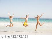 Купить «Happy young friends jumping on the beach», фото № 22172131, снято 20 октября 2015 г. (c) Wavebreak Media / Фотобанк Лори