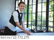 Купить «Waitress setting the table», фото № 22172275, снято 23 ноября 2015 г. (c) Wavebreak Media / Фотобанк Лори