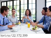 Купить «Business people having a meeting in restaurant», фото № 22172399, снято 23 ноября 2015 г. (c) Wavebreak Media / Фотобанк Лори