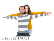 Купить «Young couple standing with arms outstretched», фото № 22174431, снято 7 октября 2015 г. (c) Wavebreak Media / Фотобанк Лори