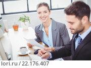 Купить «Businesswoman sitting beside male colleague at computer desk», фото № 22176407, снято 1 ноября 2015 г. (c) Wavebreak Media / Фотобанк Лори