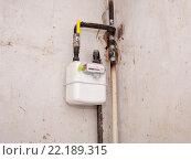 Купить «Установка бытового газового счетчика», фото № 22189315, снято 13 марта 2016 г. (c) Oleksandr Khalimonov / Фотобанк Лори