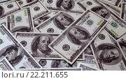 Купить «Фон из сто долларовых банкнот», видеоролик № 22211655, снято 28 января 2016 г. (c) Андрей Армягов / Фотобанк Лори