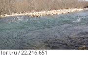 Купить «Бурный перекат на таежной реке и всплески от бросаемых камней», видеоролик № 22216651, снято 8 марта 2014 г. (c) Олег Хархан / Фотобанк Лори