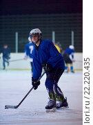 Купить «ice hockey player in action», фото № 22220435, снято 22 мая 2019 г. (c) easy Fotostock / Фотобанк Лори