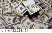 Купить «Фон из купюр по 100 долларов», видеоролик № 22224431, снято 28 января 2016 г. (c) Андрей Армягов / Фотобанк Лори