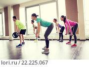Купить «group of people exercising with barbell in gym», фото № 22225067, снято 5 апреля 2015 г. (c) Syda Productions / Фотобанк Лори