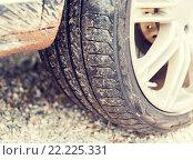 Купить «close up of dirty car wheel on ground», фото № 22225331, снято 28 марта 2015 г. (c) Syda Productions / Фотобанк Лори