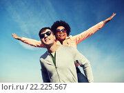 Купить «happy teenage couple in shades having fun outdoors», фото № 22225567, снято 19 марта 2015 г. (c) Syda Productions / Фотобанк Лори