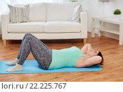 Купить «plus size woman exercising on mat at home», фото № 22225767, снято 21 февраля 2016 г. (c) Syda Productions / Фотобанк Лори
