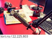 Купить «microphone at recording studio or radio station», фото № 22225803, снято 8 апреля 2015 г. (c) Syda Productions / Фотобанк Лори