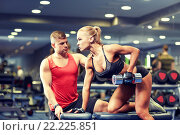 Купить «young couple with dumbbell flexing muscles in gym», фото № 22225851, снято 19 апреля 2015 г. (c) Syda Productions / Фотобанк Лори