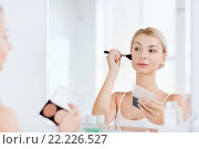Купить «woman with makeup brush and foundation at bathroom», фото № 22226527, снято 13 февраля 2016 г. (c) Syda Productions / Фотобанк Лори