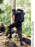 Купить «young soldier with backpack in forest», фото № 22226559, снято 14 августа 2014 г. (c) Syda Productions / Фотобанк Лори