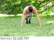 Купить «young man doing push ups on grass in summer park», фото № 22226767, снято 25 августа 2015 г. (c) Syda Productions / Фотобанк Лори