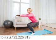 Купить «smiling woman with dumbbells exercising at home», фото № 22226815, снято 7 февраля 2016 г. (c) Syda Productions / Фотобанк Лори