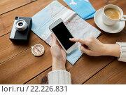 Купить «close up of traveler hands with smartphone and map», фото № 22226831, снято 8 февраля 2016 г. (c) Syda Productions / Фотобанк Лори