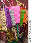 Купить «Colorful mesh bags for sale at the street in the historic center, Oaxaca, Oaxaca State Mexico, Central America.», фото № 22230907, снято 4 февраля 2016 г. (c) age Fotostock / Фотобанк Лори