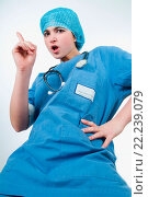 Купить «Nurse with blue uniform view from below shaking her index finger to scold someone doing an angry facial expression», фото № 22239079, снято 19 января 2019 г. (c) age Fotostock / Фотобанк Лори