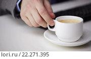Купить «close up of businessman typing and drinking coffee», видеоролик № 22271395, снято 4 апреля 2015 г. (c) Syda Productions / Фотобанк Лори