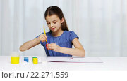 Купить «happy girl painting with gouache color at home», видеоролик № 22271559, снято 13 декабря 2015 г. (c) Syda Productions / Фотобанк Лори