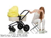 Купить «Woman with baby and pram isolated on white», фото № 22275035, снято 6 сентября 2015 г. (c) Elnur / Фотобанк Лори