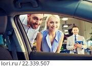 happy couple with car dealer in auto show or salon, фото № 22339507, снято 22 января 2015 г. (c) Syda Productions / Фотобанк Лори