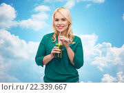Купить «smiling woman drinking vegetable juice or smoothie», фото № 22339667, снято 7 февраля 2016 г. (c) Syda Productions / Фотобанк Лори
