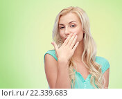 Купить «smiling young woman or teen girl covering mouth», фото № 22339683, снято 13 февраля 2016 г. (c) Syda Productions / Фотобанк Лори