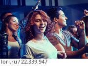 Купить «happy friends dancing at night club», фото № 22339947, снято 20 октября 2014 г. (c) Syda Productions / Фотобанк Лори