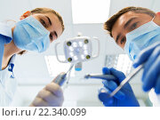 Купить «close up of dentist and assistant at dental clinic», фото № 22340099, снято 23 мая 2015 г. (c) Syda Productions / Фотобанк Лори