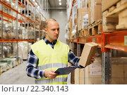 Купить «man with clipboard in safety vest at warehouse», фото № 22340143, снято 9 декабря 2015 г. (c) Syda Productions / Фотобанк Лори