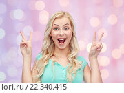 Купить «smiling young woman or teenage girl showing peace», фото № 22340415, снято 13 февраля 2016 г. (c) Syda Productions / Фотобанк Лори