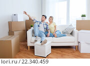 Купить «couple with boxes moving to new home and dreaming», фото № 22340459, снято 25 февраля 2016 г. (c) Syda Productions / Фотобанк Лори