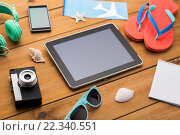 Купить «close up of tablet pc and travel stuff», фото № 22340551, снято 8 февраля 2016 г. (c) Syda Productions / Фотобанк Лори