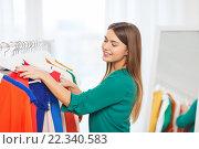 Купить «happy woman choosing clothes at home wardrobe», фото № 22340583, снято 19 февраля 2016 г. (c) Syda Productions / Фотобанк Лори