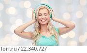 Купить «happy young woman or teenage girl with headphones», фото № 22340727, снято 13 февраля 2016 г. (c) Syda Productions / Фотобанк Лори