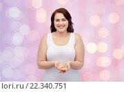 Купить «happy plus size woman in underwear with pills», фото № 22340751, снято 21 февраля 2016 г. (c) Syda Productions / Фотобанк Лори