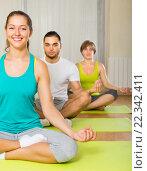 Купить «Group having yoga class», фото № 22342411, снято 20 января 2019 г. (c) Яков Филимонов / Фотобанк Лори