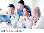 Купить «group of doctors looking at x-ray», фото № 22356027, снято 18 мая 2013 г. (c) Syda Productions / Фотобанк Лори