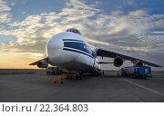 Купить «Крупнейший в мире грузовой самолет Руслан Ан-124-100 (Россия) на заправке в аэропорту Аль-Аин (ОАЭ, весна 2013), ранним утром на фоне облаков и восходящего солнца», фото № 22364803, снято 17 ноября 2013 г. (c) oleg savichev / Фотобанк Лори