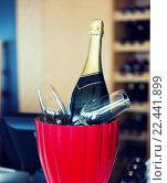 Купить «close up of champagne and glasses at restaurant», фото № 22441899, снято 30 апреля 2015 г. (c) Syda Productions / Фотобанк Лори