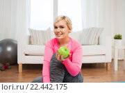 Купить «happy woman eating green apple at home», фото № 22442175, снято 7 февраля 2016 г. (c) Syda Productions / Фотобанк Лори