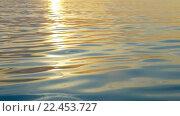 Купить «Rippling water with sunset reflection», видеоролик № 22453727, снято 15 декабря 2015 г. (c) Данил Руденко / Фотобанк Лори