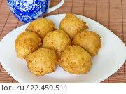Купить «Пончики творожные домашнего приготовления», фото № 22459511, снято 3 апреля 2016 г. (c) Елена Коромыслова / Фотобанк Лори
