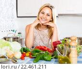 Купить «Woman cutting vegetables for dinner», фото № 22461211, снято 9 июля 2020 г. (c) Яков Филимонов / Фотобанк Лори
